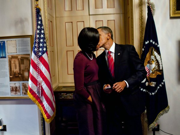 President Barack Obama Kisses First Lady Michelle Obama after his First State of the Union