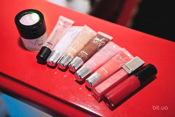 Beauty Rush Lip Gloss, Victoria's Secret; Kiss Kiss Gloss, Guerlain; Lustreglass Lip Gloss, M.A.C; PRO Smooth FX Lip Scrub & Balm, Victoria's Secret