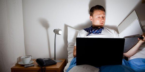 man-bed-working