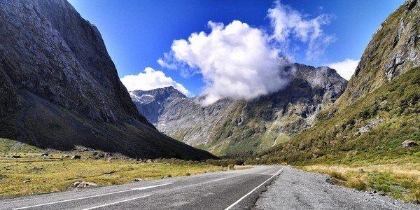 the-milford-road-in-new-zealand-winds-for-144-miles-through-fiordland-national-park-in-the-heart-of-the-southern-alps-it-also-connects-to-milford-sound-one-of-the-filming-locations-for-the-lord-of-the-rings-trilogy
