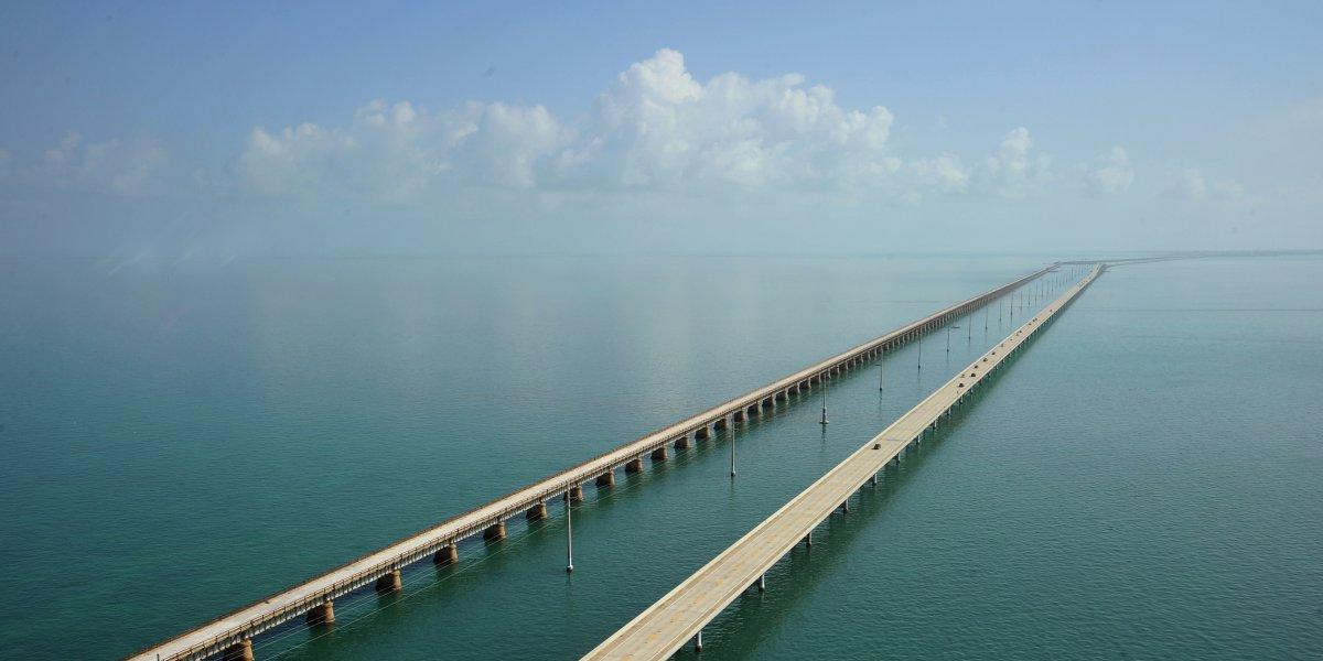 the-overseas-highway-in-florida-connects-mainland-florida-to-the-florida-keys-and-consists-of-42-overseas-bridges-across-113-miles-youll-feel-like-youre-driving-on-the-surface-of-the-ocean-try-to-catch-a-sunrise-or-a
