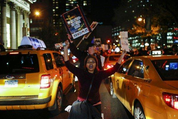 Protesters shout slogans against the law as they march on the street during a rally in New York