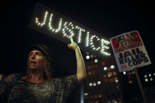 Woman holds a sign as protesters rally in New York