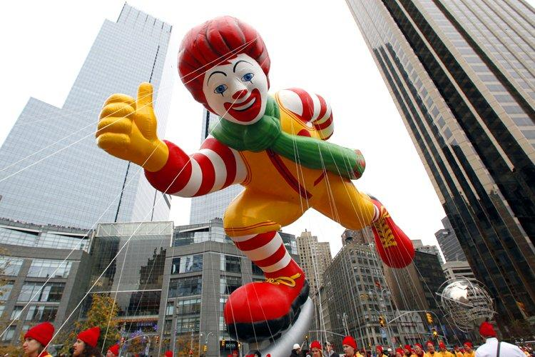 The Ronald McDonald balloon floats through Columbus Circle during the 84th Macy's Thanksgiving day parade in New York