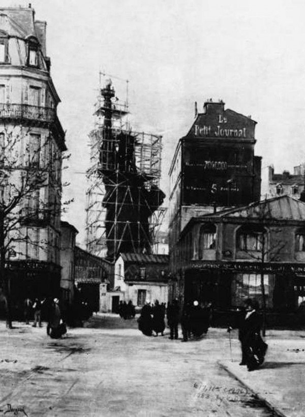 View of the Statue of Liberty enclosed by scaffolding, while under construction, seen from the Rue de Chazelles, Paris, France, circa 1884. (Photo by Paul-Joseph-Victor Dargand/Frederic Lewis/Getty Images)