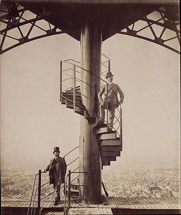 Engineer Alexandre Gustave Eiffel poses high on top of the completed Eiffel Tower in 1889