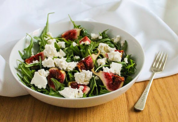 Fig and feta salad half white background