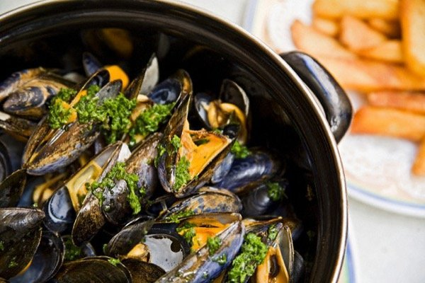 """Nice, France --- Mussles and chips, typical """"moules et frites"""" --- Image by © Sandra Raccanello/Grand Tour/Corbis"""