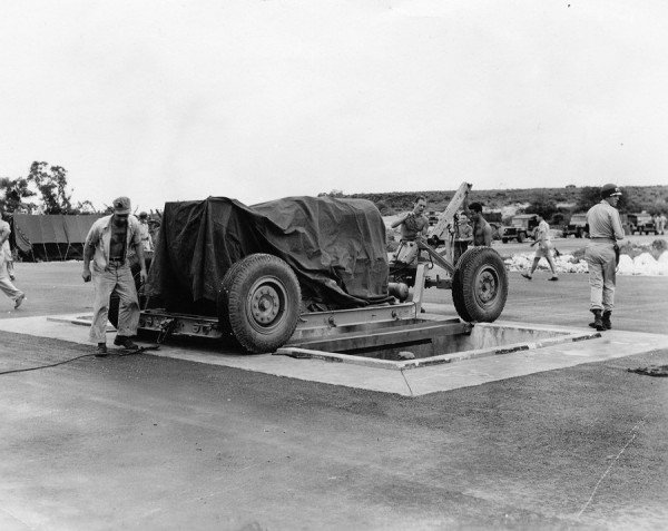 at-the-airfield-fat-man-is-lined-up-over-a-pit-specifically-constructed-for-it-from-which-it-is-then-loaded-into-the-plane-that-dropped-it-over-nagasaki-on-august-9-1945