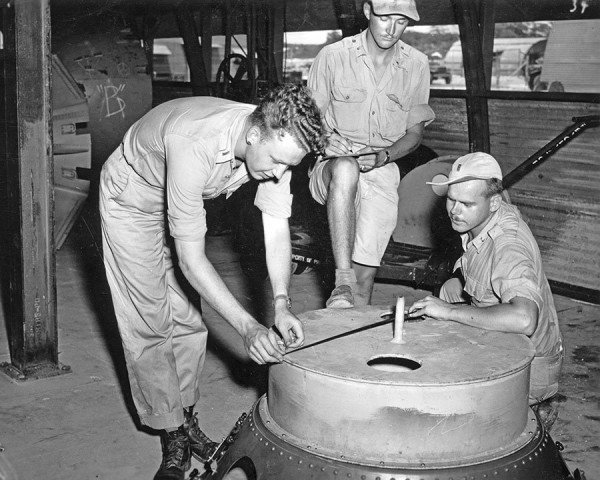 soldiers-check-the-casings-on-the-fat-man-atomic-bomb-multiple-test-bombs-were-created-on-tinian-island-all-were-roughly-identical-to-an-operational-bomb-even-though-they-lacked-the-necessary-equipment-to-d