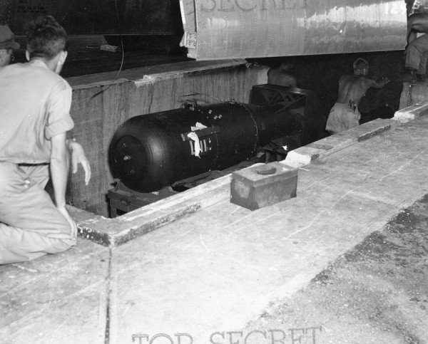 the-tarp-is-removed-and-the-bomb-is-readied-for-loading