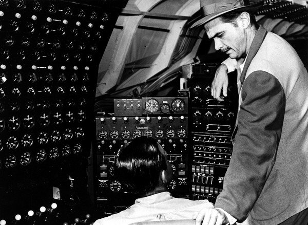 """Stage and Screen Business. Aviation. Personalities. pic: 1947. Millionaire American Howard Hughes pictured with an engineer on the vast wooden sea-plane """"Spruce Goose"""" which he designed. Howard Hughes, (1905-1976) millionaire Businessman, Aviator and fil"""