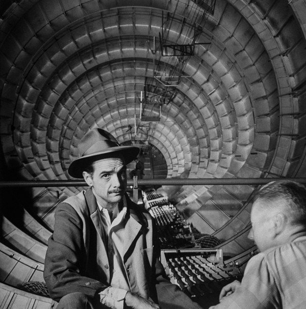 Millionaire Howard Hughes in cockpit of huge sea plane, the Spruce Goose, which he designed and built.