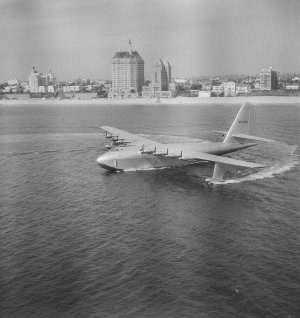 "Howard Hughes' H-4 Hercules troop transport plane, the ""Spruce Goose,"" Long Beach Harbor."