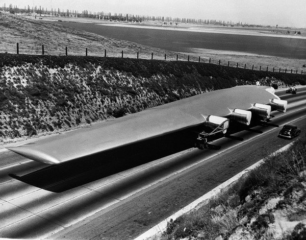 View of Howard Hughes Flying Boat Wing Next to Car