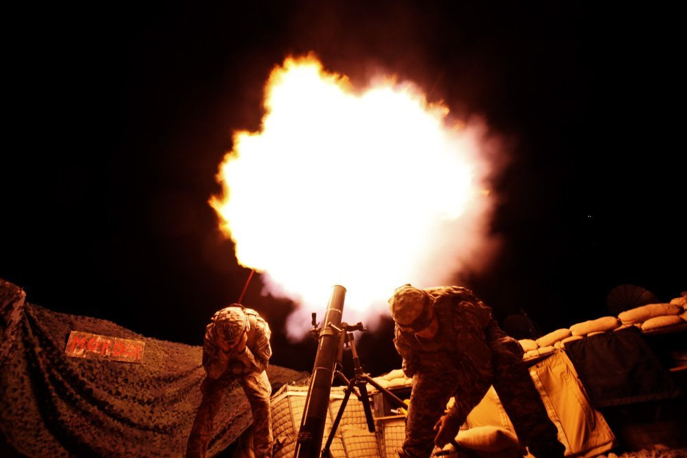 Soldiers from the U.S. Army's 3rd Battalion, 509th Infantry Regiment (Airborne), based at Fort Richardson, Alaska, fire 120mm mortar during a fire mission at the combat outpost Zerok in East Paktika province in Afghanistan, Wednesday, Sept. 23, 2009. (AP Photo/Dima Gavrysh)