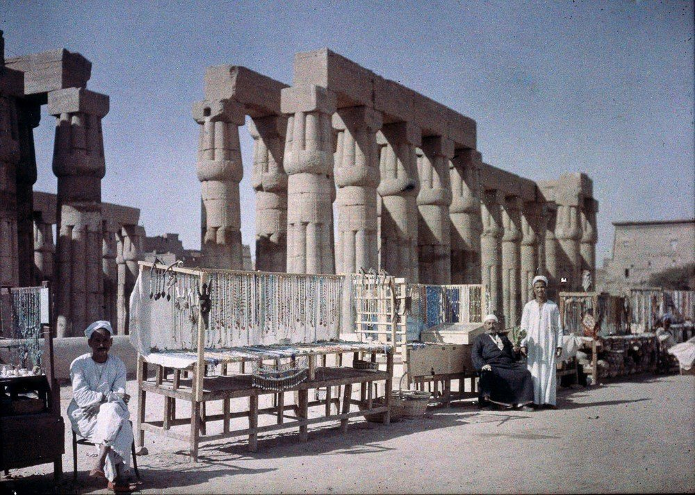 Egyptian market stalls outside a temple ruin, c 1920-1930.