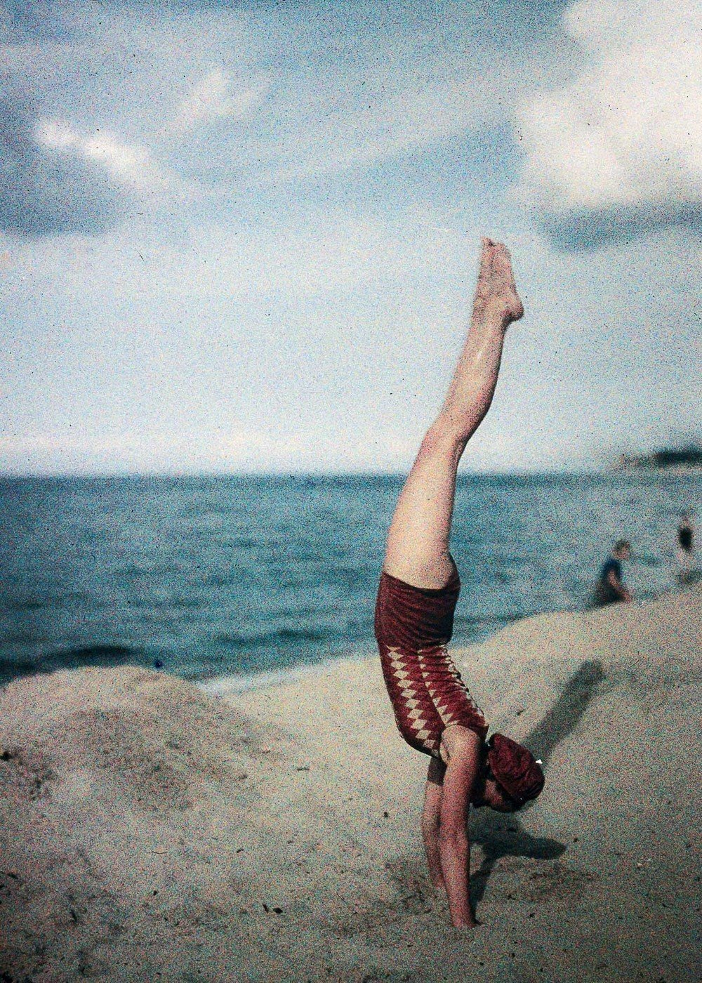 Eva doing a handstand, c 1920s.