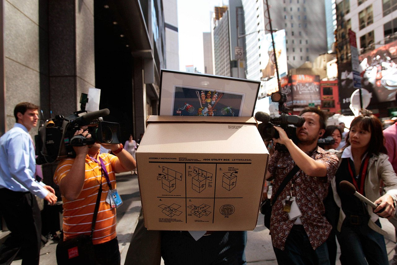 NEW YORK - SEPTEMBER 15: An employee of Lehman Brothers Holdings Inc. carries a box out of the company's headquarters as he is followed by the media September 15, 2008 in New York City. Lehman Brothers filed a Chapter 11 bankruptcy petition in U.S. Bankruptcy Court after attempts to rescue the storied financial firm failed. (Photo by Chris Hondros/Getty Images)