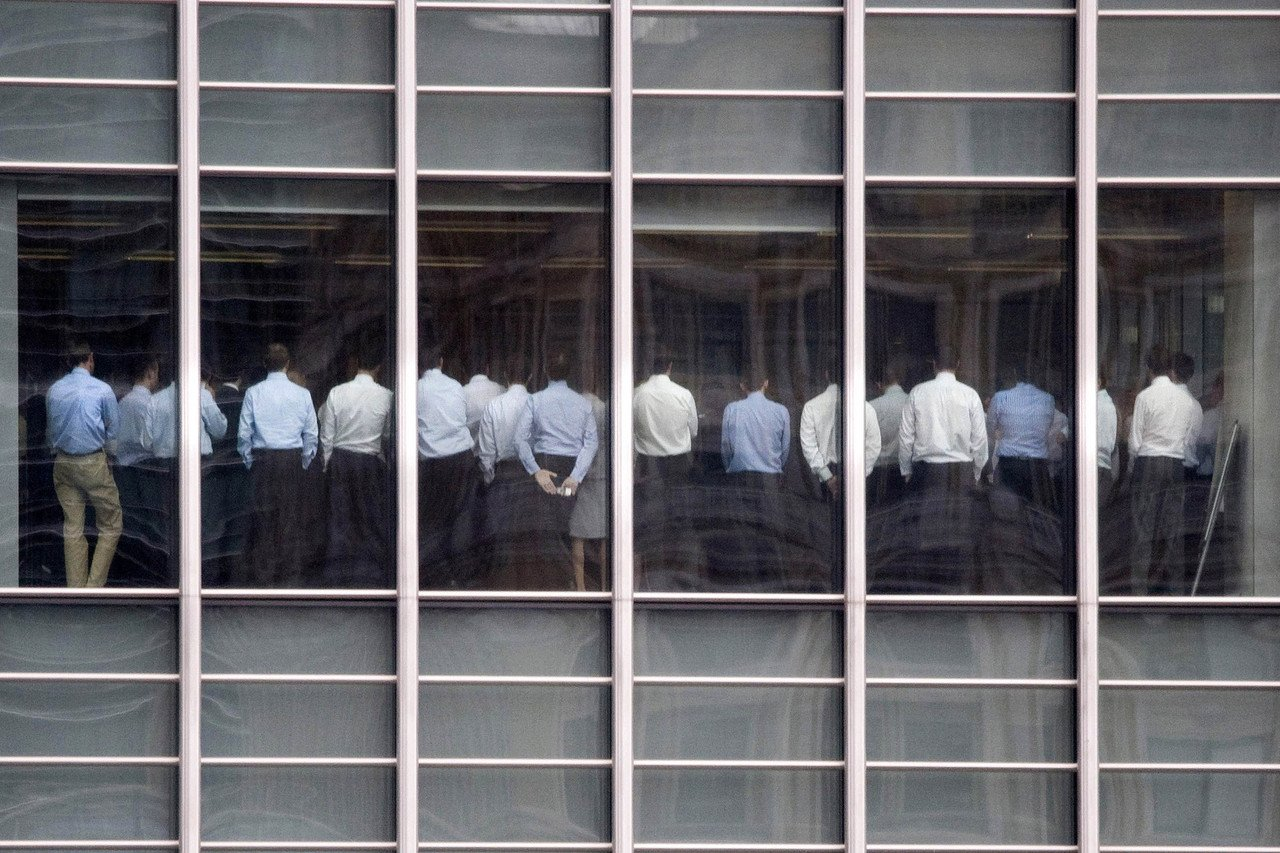 Staff are seen standing in a meeting room at Lehman Brothers offices in the financial district of Canary Wharf, in London in this September 11, 2008 file photograph. Some creditors of Lehman Brothers International (Europe) will likely lose their money, but it will take a long time before it becomes clear how much, administrators Pricewaterhouse Coopers (PwC) said on November 14, 2008. . Photograph taken on September 11, 2008. REUTERS/Kevin Coombs/Files (BRITAIN)