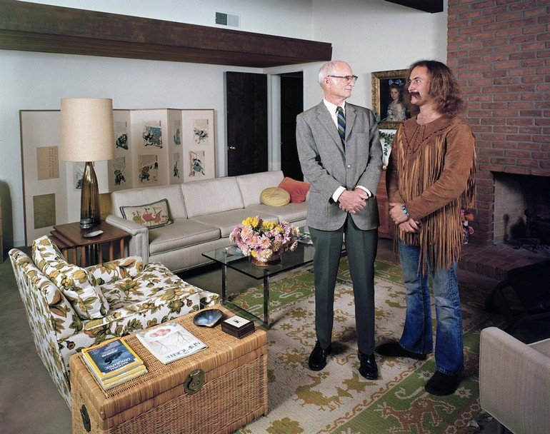 Singer David Crosby (R) standing w. father Floyd in father's house.