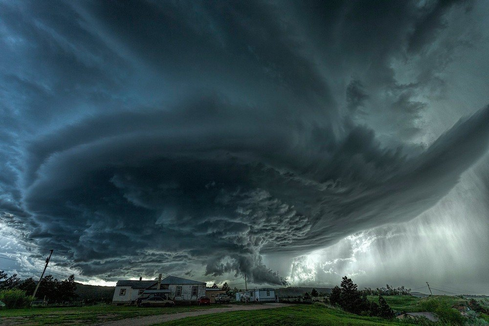 stock-A-supercell-thunderstorm-rises-over-the-town-of-Blackhawk-South-Dakota.