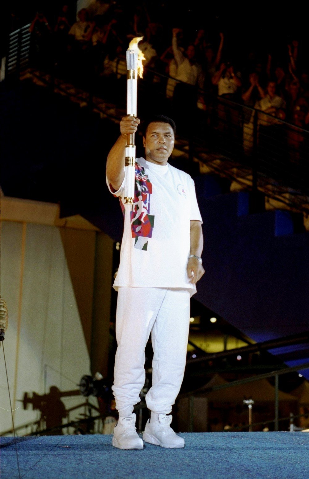 19 Jul 1996: Muhammad Ali holds the torch before lighting the Olympic Flame during the Opening Ceremony of the 1996 Centennial Olympic Games in Atlanta, Georgia. Mandatory Credit: Michael Cooper /