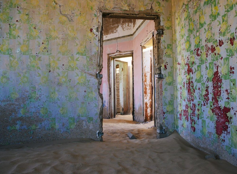 the-wallpaper-is-different-in-each-room-and-the-contrast-of-these-incredibly-colorful-old-peeling-wallpapers-and-the-sand-is-so-surreal-she-says
