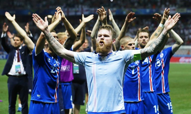 epa05395426 Aron Gunnarsson (front) of Iceland and his teammates celebrate after the UEFA EURO 2016 round of 16 match between England and Iceland at Stade de Nice in Nice, France, 27 June 2016. Iceland won 2-1. (RESTRICTIONS APPLY: For editorial news reporting purposes only. Not used for commercial or marketing purposes without prior written approval of UEFA. Images must appear as still images and must not emulate match action video footage. Photographs published in online publications (whether via the Internet or otherwise) shall have an interval of at least 20 seconds between the posting.) EPA/SEBASTIEN NOGIER EDITORIAL USE ONLY