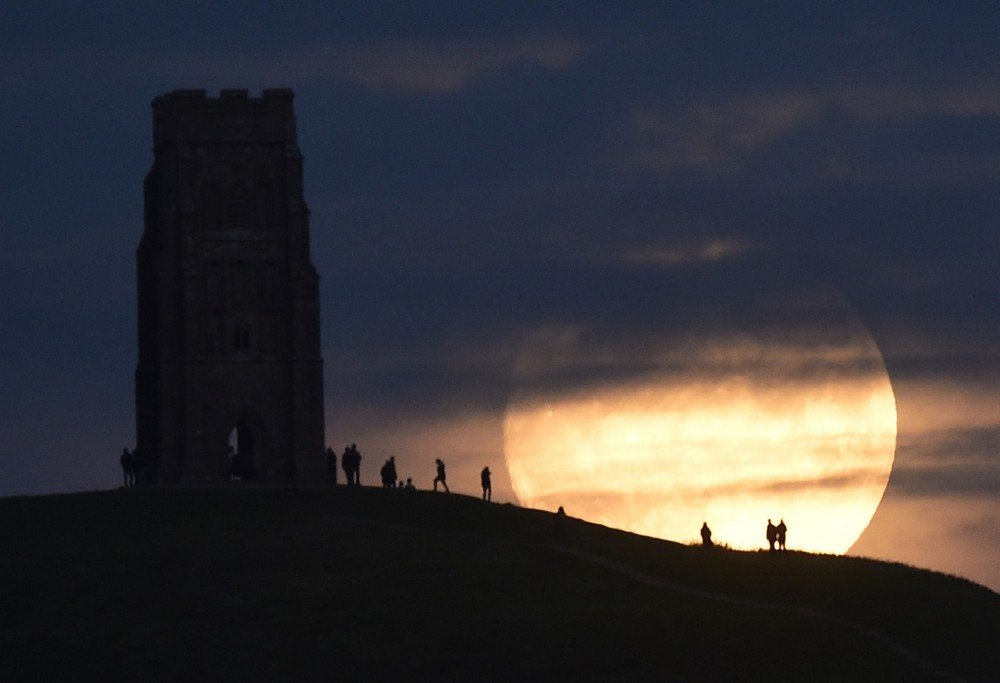 "The moon rises near Glastonbury Tor a day before the ""supermoon"" spectacle, in Glastonbury"