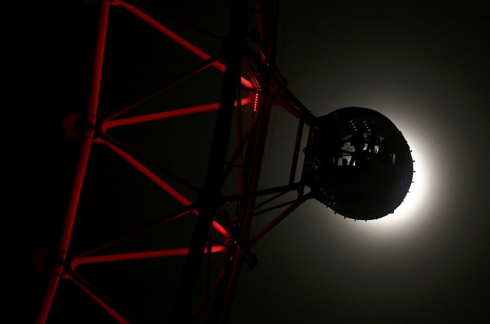 "A pod on the London Eye is seen against the moon a day before the ""supermoon"" spectacle, in London"