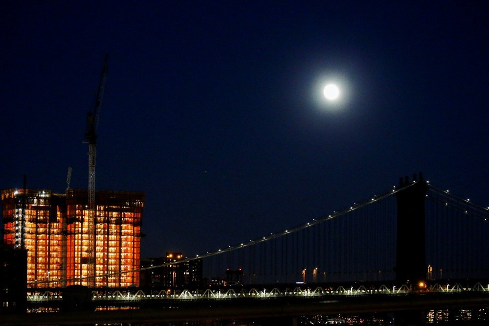 "A full moon is seen over the Manhattan Bridge during the eve of the ""supermoon"" in New York"