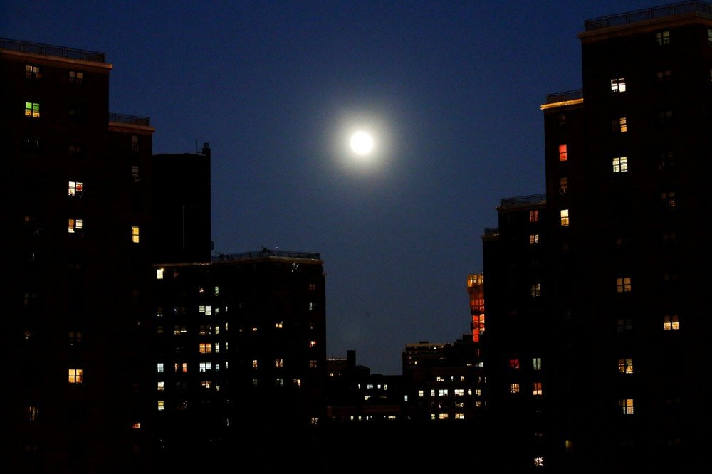 "A full moon is seen during the eve of the ""supermoon"" in the lower Manhattan in New York"