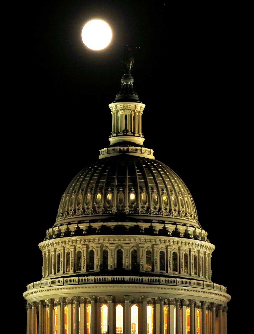Supermoon rises over US Capitol dome in Washington