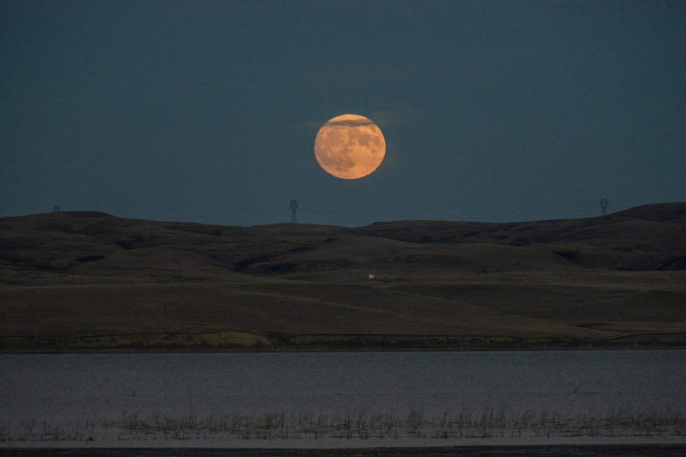 The supermoon rises over the Missouri River, pictured from the Standing Rock Indian Reservation near Cannon Ball, North Dakota, U.S.