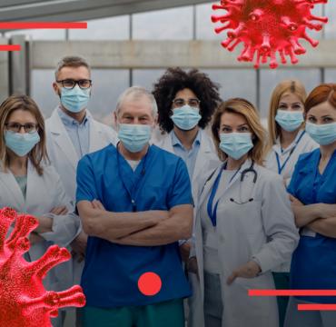 на фото група лікарів в захисних масках